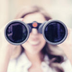 Woman infidelity investigator looking through binoculars